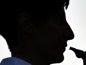 Silhouette der Schiedsrichterin Marina Wozniak.