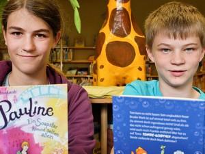 """Nele und Niels freuen sich darauf in den neuen Kinder- und Jugendbücher zu """"schmökern"""". ©Thomas Schmidt, Stadt Herne"""
