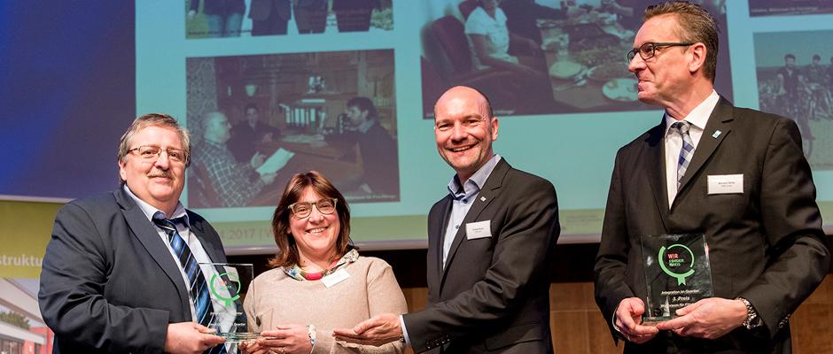 Bei der Preisübergabe ( v.l.n.r.): Michael Barszap (gfi-Geschäftsführer), Chiara Cremon (gfi-Schatzmeisterin), Thomas Bruns (HGW-Geschäftsführer), Norbert Riffel (WIR-Vorstandssprecher).